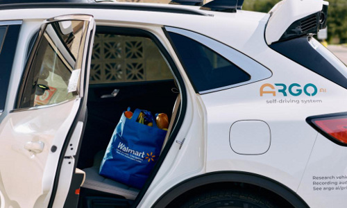 A Walmart bag on the back seat of a self-driving Argo AI vehicle.